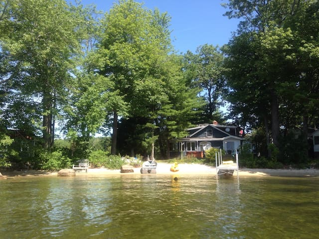 View of the house from the lake. Great beach with shallow entry.