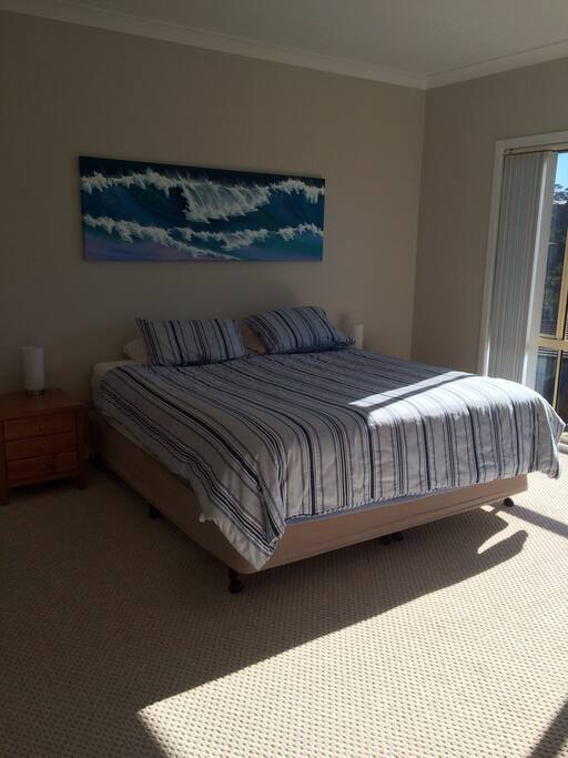 Main bedroom with ocean views, walk- in wardrobe and ensuite