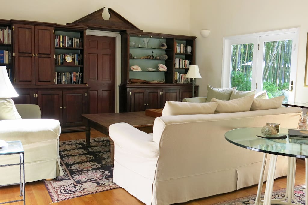 """The living room with 32"""" high ceilings is great for entertaining."""