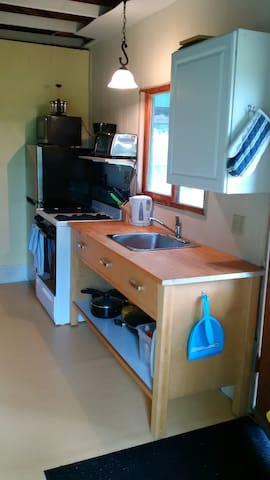 Kitchen with new fridge - Mircrowave and stove along with all you need