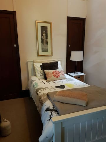 5th Bedroom with a King single Bed and Desk.