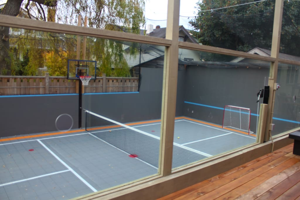 This is the back deck and court. The back deck has a gas barbeque and sitting for a family.