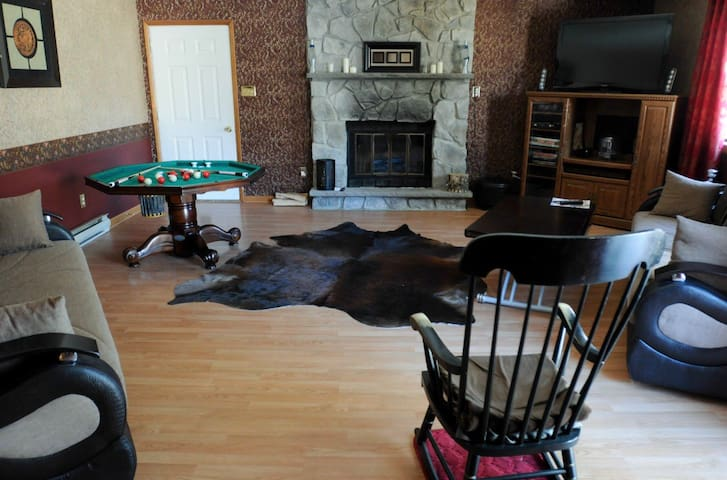 Not a bedroom but a separate game room with wood fireplace, 2 pullout queen sofa beds (can sleep 4), a game table & smart tv, walk-out sliding door to jacuzzi.