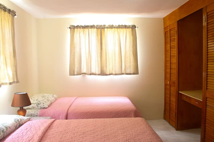 Bedroom configured with 2 twin beds.