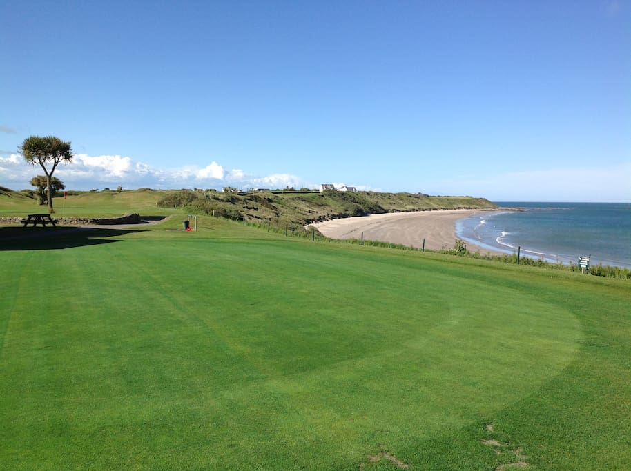 Golf course beside beach