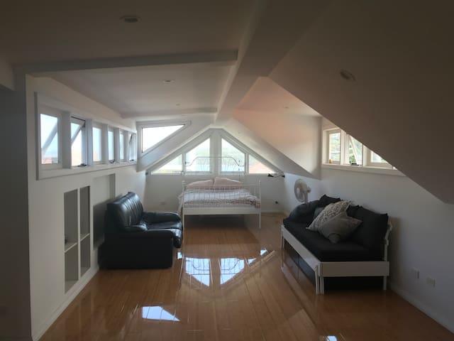 Massive bright beachside room (entire top floor)