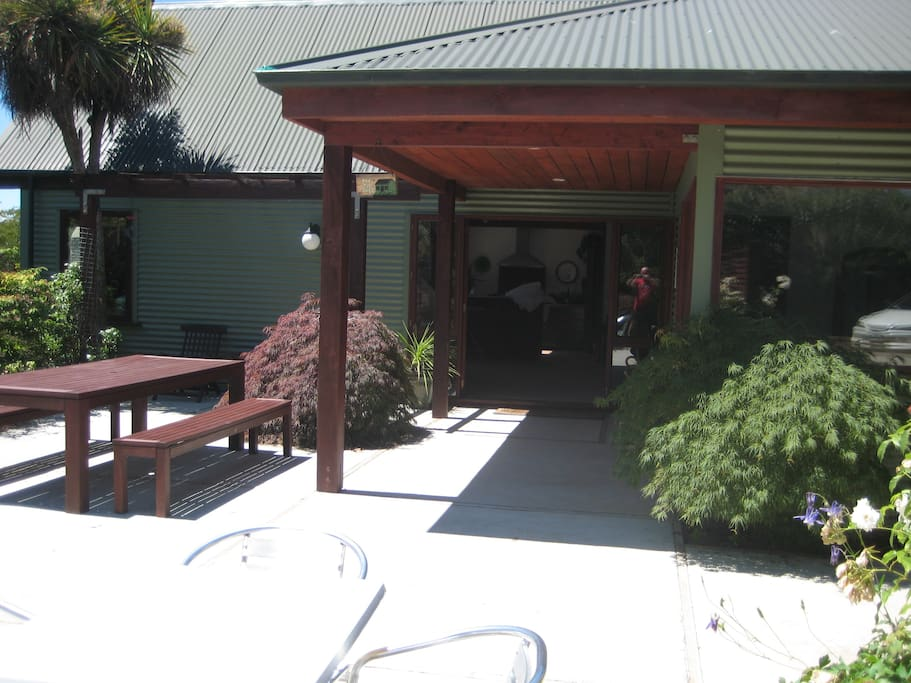 you access the ensuite room from this patio, and all guests are welcome to use