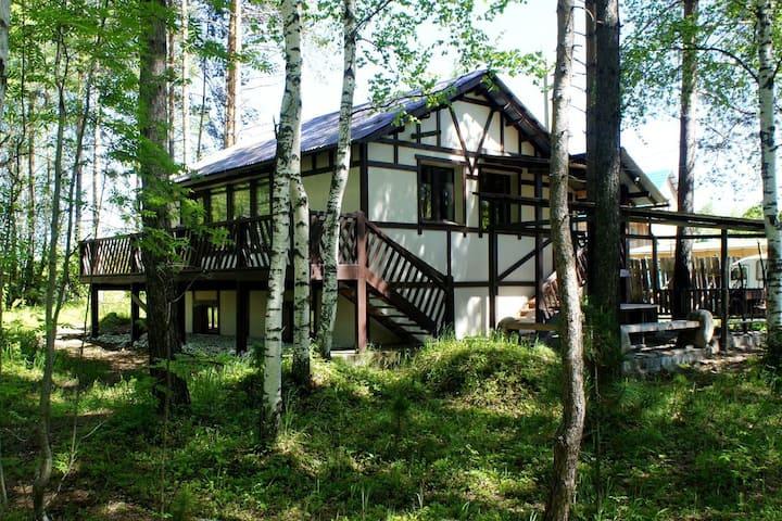 Alpine house on Baikal shore