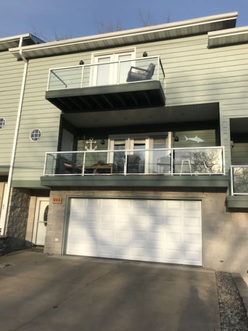 3 Story Townhouse with 2.5 car garage on main floor and two balconies with Lake Michigan views!