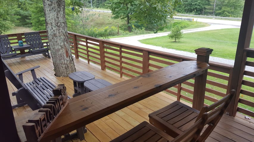 Open Porch Area with Bar and Tree Growing Thru It