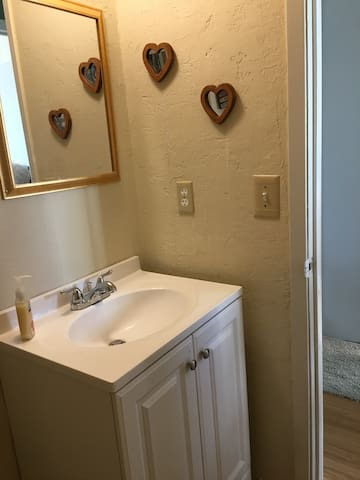 Vanity with toiletries in a small clean bathroom