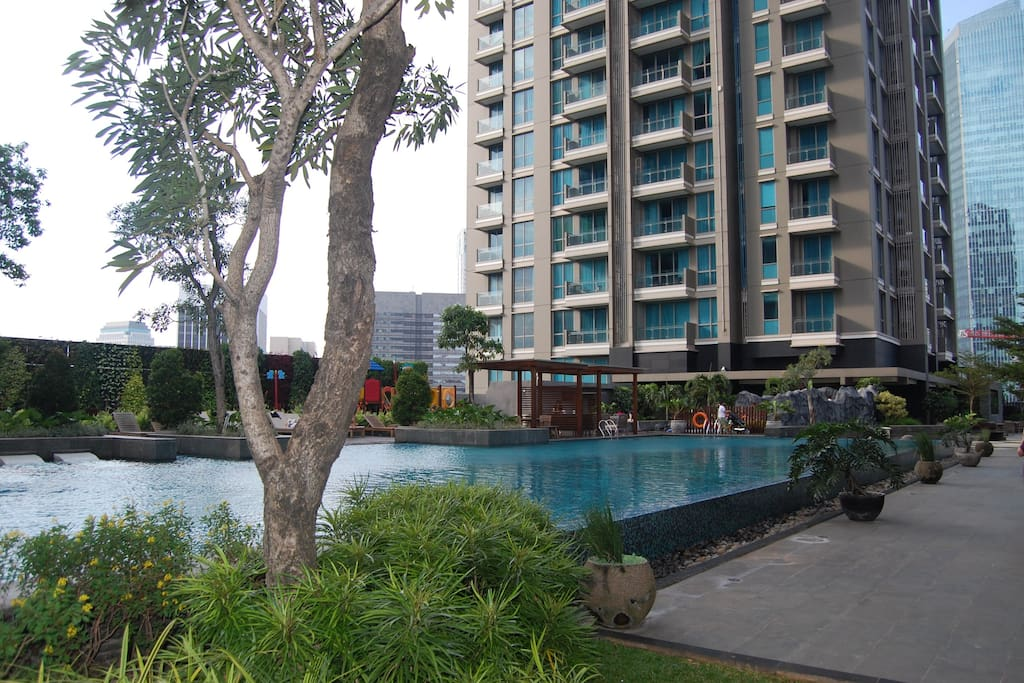 Huge lap pool with children playground and other great facilities
