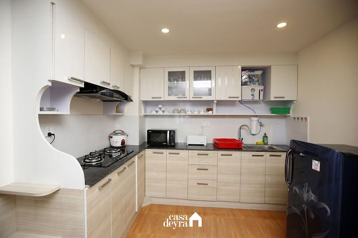 Fully equipped kitchen with all cabinets closed