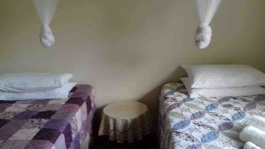 Bedroom B is set up with two twin beds.
