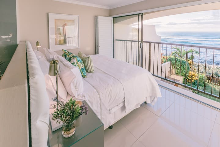 Main bedroom with an ocean view