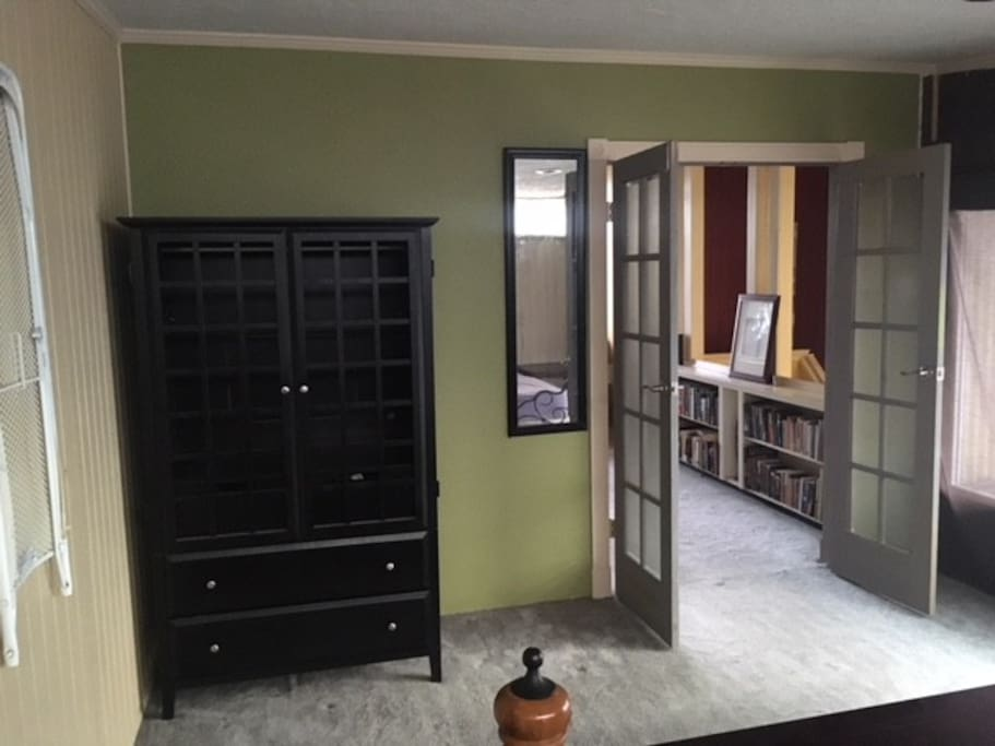 Iron, ironing board, armoire, French doors