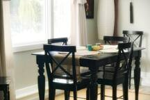 Dining area with large picture window to enjoy views of our private acreage