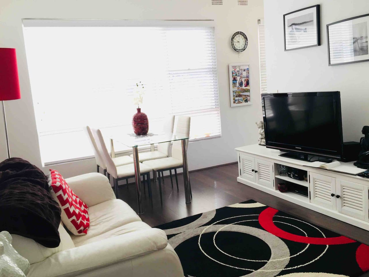 Sunny lounge/dining room.   Seating for four at glass dining room table.  Two  x 2 seater white leather lounges.  A/C, fans, TV, Recorder, radio/CD player. Netflix.  North facing, balcony off lounge room to dry your clothes on line provided.