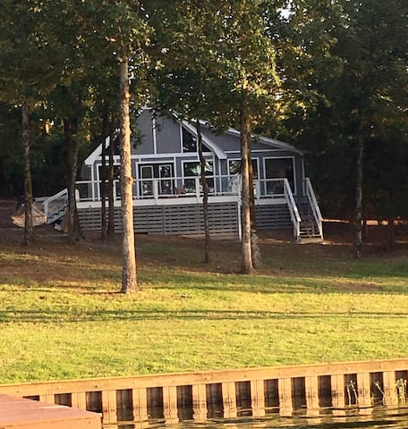 The cabin is steps from the Lake Cypress Springs!