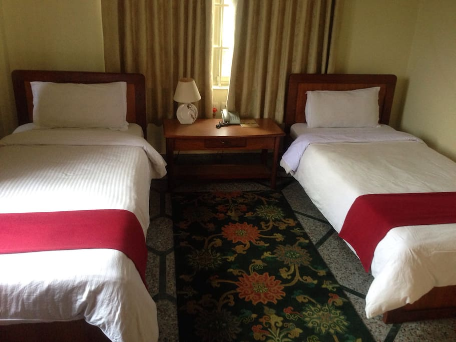 1 pax - Single Room with attached bathroom.          2 pax - Twin Room with attached bathroom.