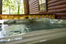Enjoy the Hot Tub on the Covered Deck. There is a Propane BBQ Grill.