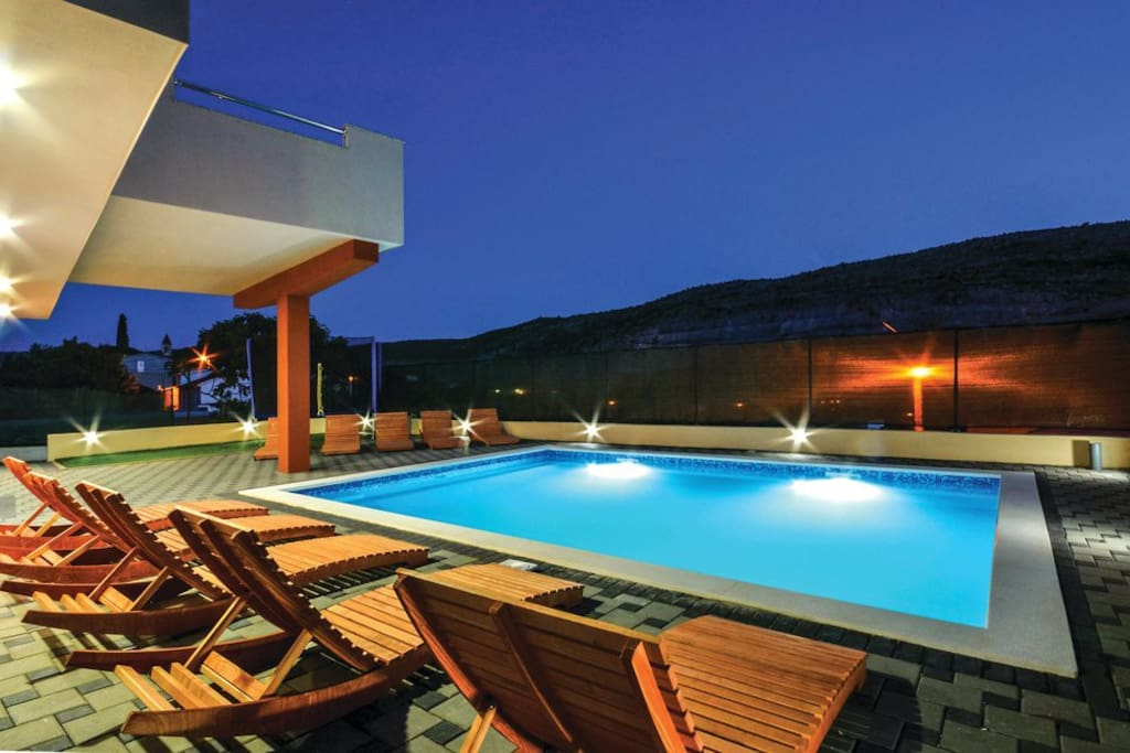 Night scenery of a pool area surrounded with beautiful nature