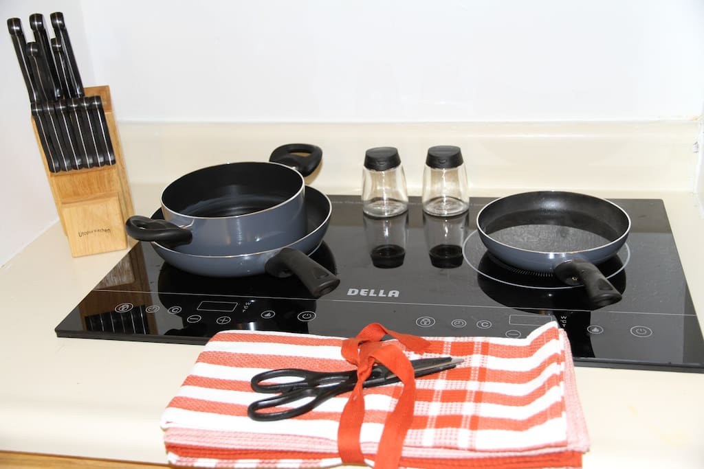 Modern Induction stove with cutting knifes, pans, etc