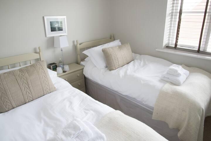 Twin room with en-suite shower room.