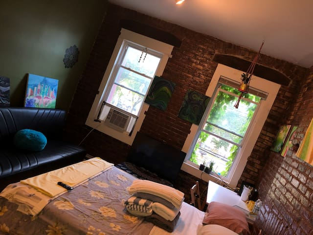 3 bedroom 1200sq ft apt with exposed brick & deck