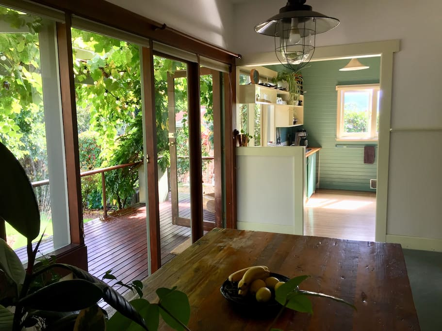 Dining table looking into the kitchen and out on to the deck