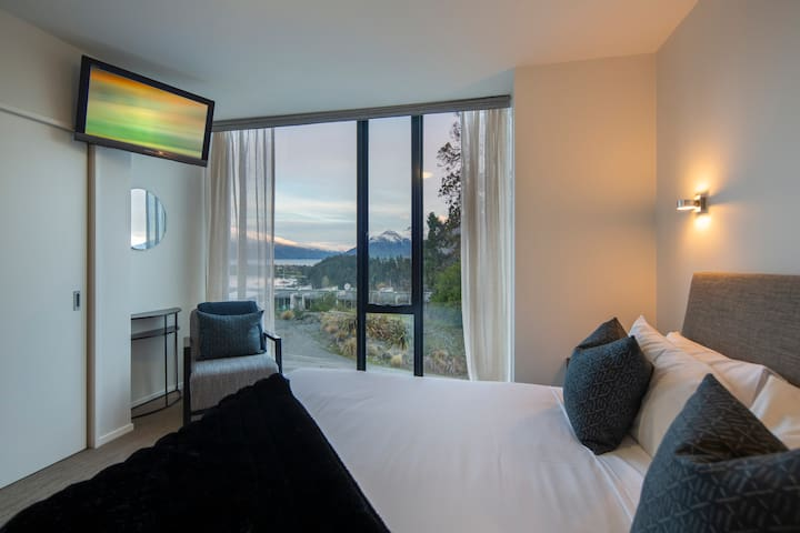 The second bedroom comes complete with a king-sized bed, LCD TV and floor-to-ceiling windows with serene lake views