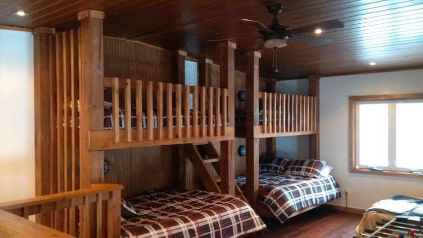 Loft (bedroom #4) consists of 2 sets of single over double custom built in bunks and a queen sofabed. All open with no door to the loft