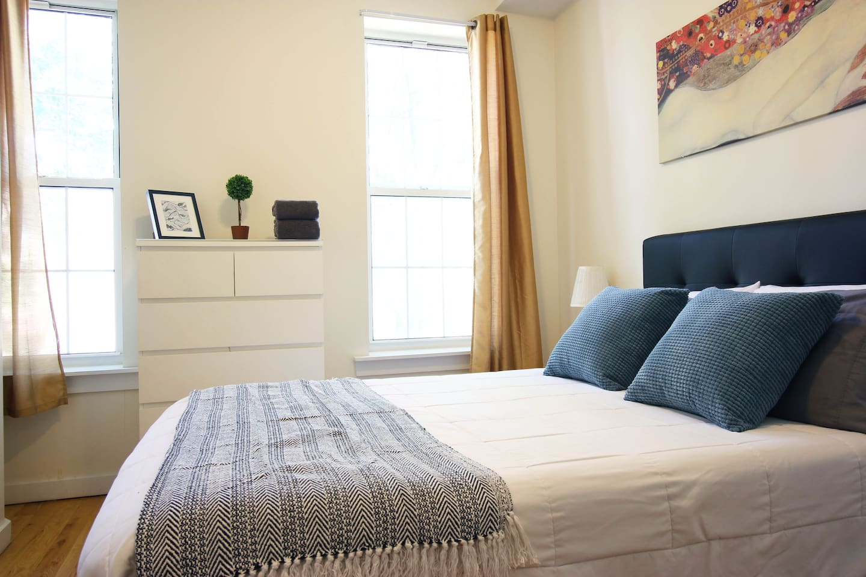 Comfortable mattress, large dresser in room