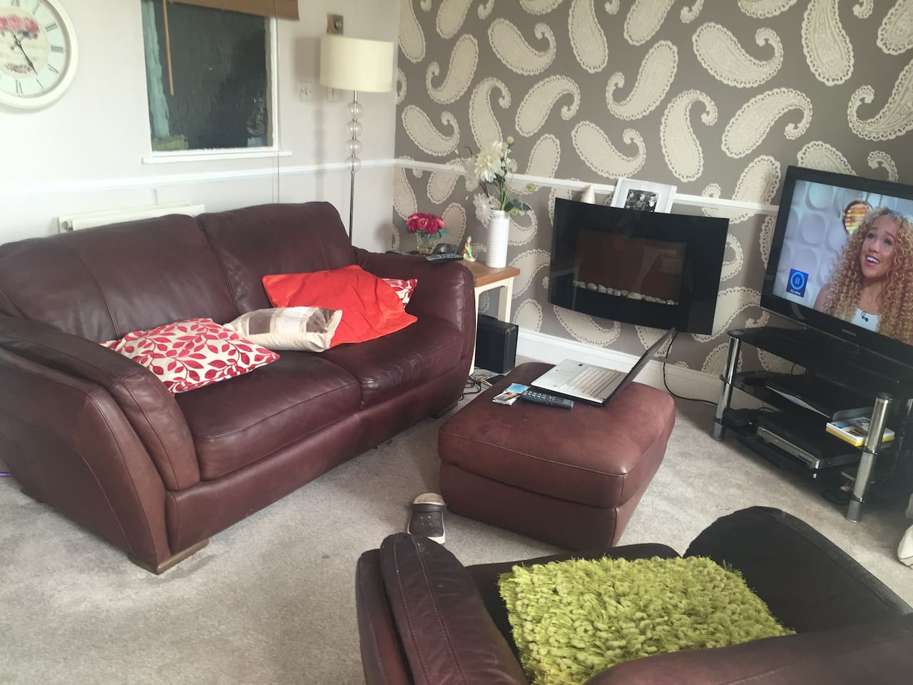 "two seater sofa and fireplace, 42"" tv and wifi, dvd"