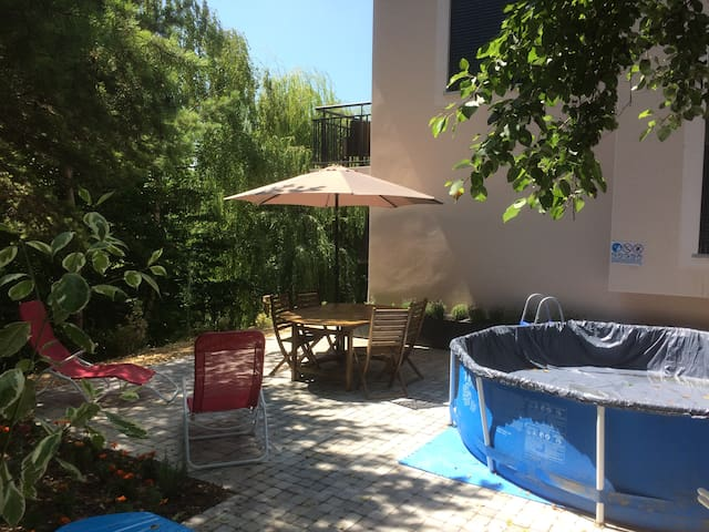 Sunny terrace with pool and barbecue