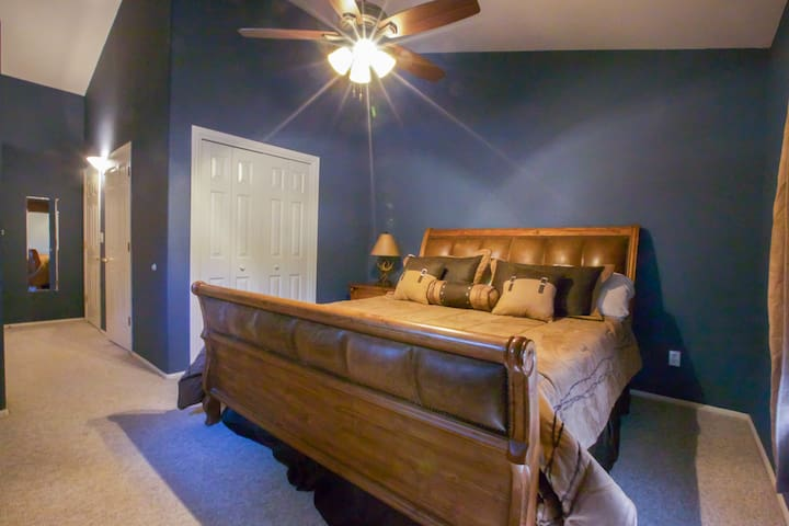 Master bedroom is upstairs on the main level and features a King size bed with Tempurpedic Cloud Supreme mattress, 4 usable non-decorative pillows, 5 decorative pillows, dresser, 3 closets, ceiling fan with dimmable lights, and blackout shades.