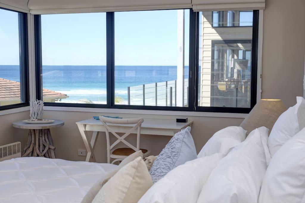 Master Bedroom with Ensuite, walk in robe and balcony with beach views