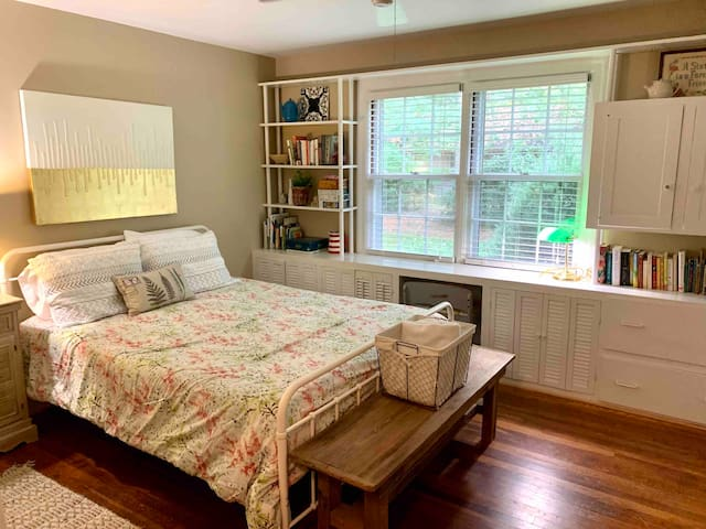 This bedroom has a queen bed with comfy mattress and soft sheets and blankets. Built-in shelves are filled with an array of games, puzzles, books and more books. It shares the hall bathroom with one other bedroom.