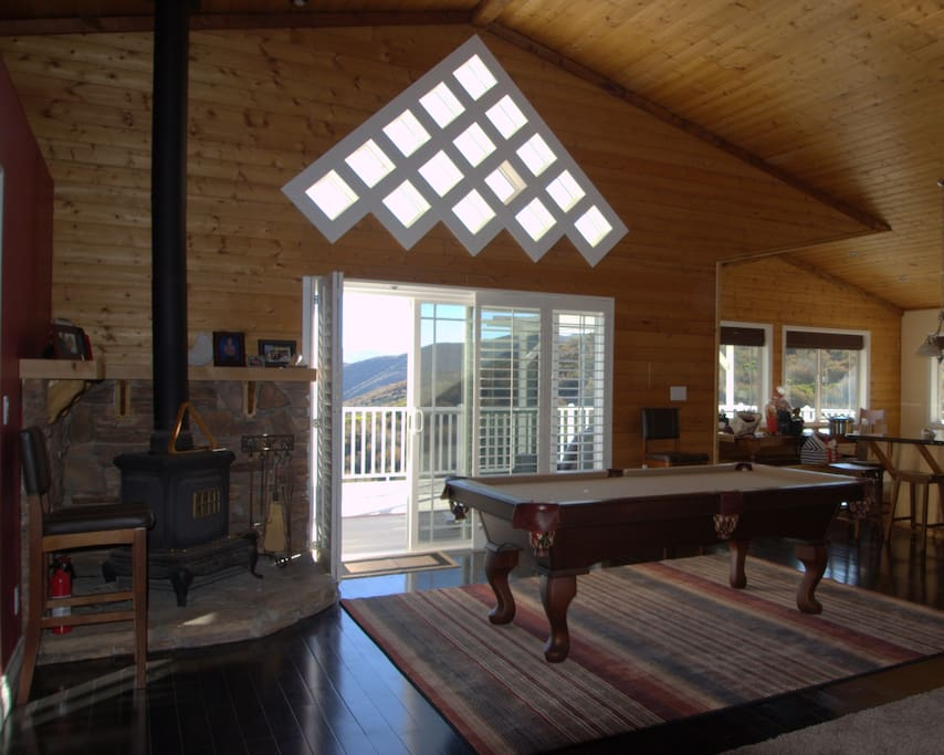 Pool table at back deck entrance.