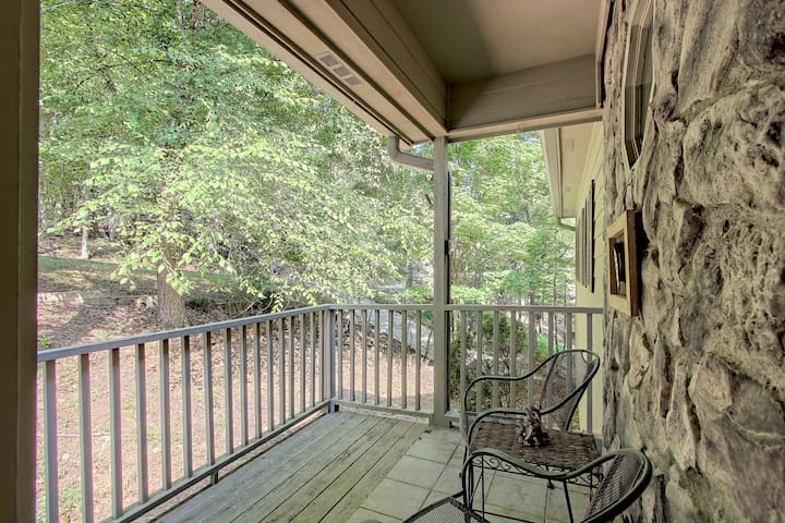 Secluded woodland home w/ a shared pool, fireplace, two decks