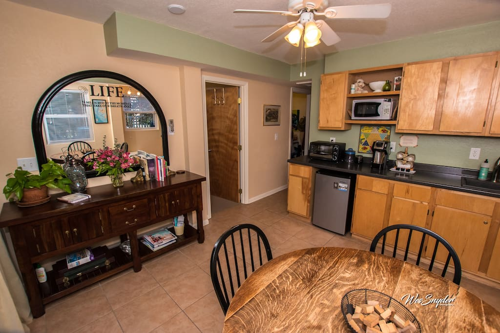 Sunny kitchen and dining area for relaxing chats or cozy lunches.