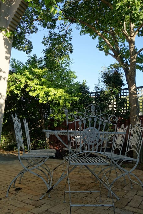Private shady terrace; the perfect place to start your day, listening to the birdsong as you eat your croissants and drink your coffee
