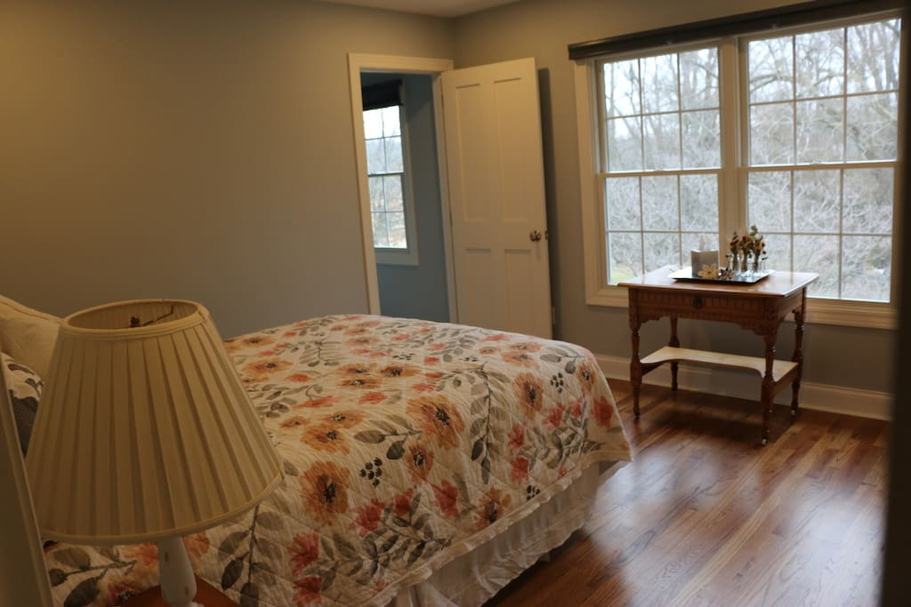 Private ensuite bedroom with queen sized bed and closet