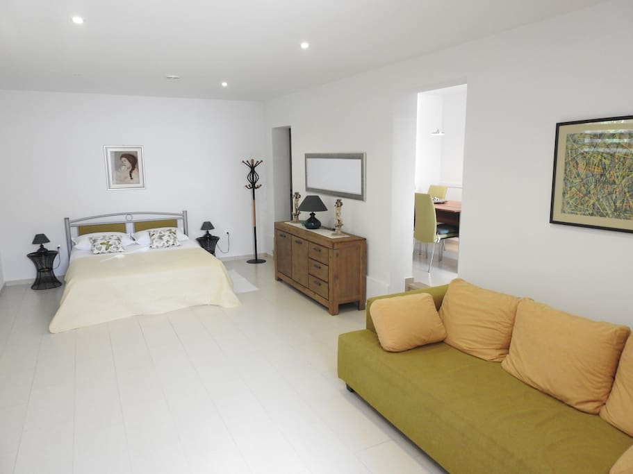 Sleeping area with double bed and sofa