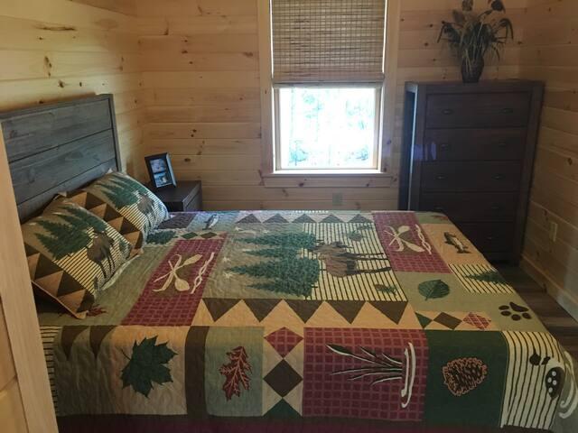 Master bedroom on first floor with queen bed.