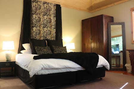 Garden Retreat King Size bed is super-comfortable and looks out directly into the rainforest