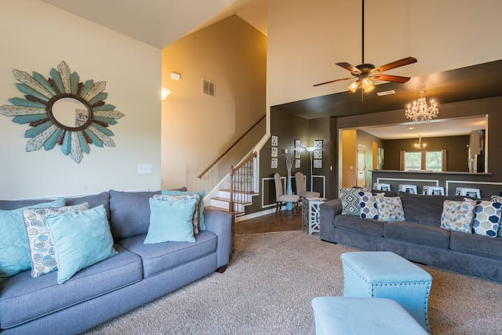 Living room/queen sofa bed with memory foam mattress.