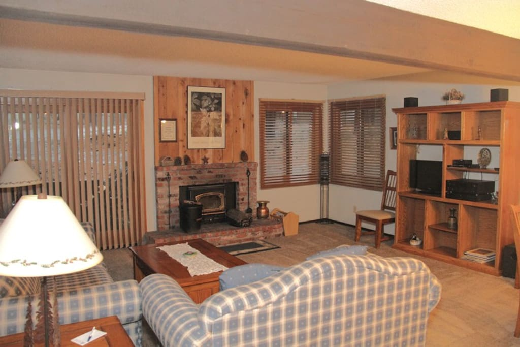 Mammoth Condo Rental Wildflower 67 - Open Area Living Room with Woodstove and Outside Private Deck