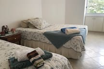 Two Twin Size beds in room 2