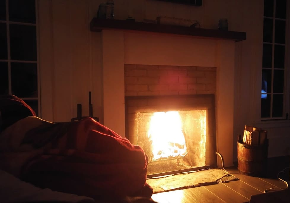 Curl up by the wood burning fireplace in the winter months. Photo thanks to one of our guests, Akeia.